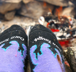 Toasting toes by the campfire